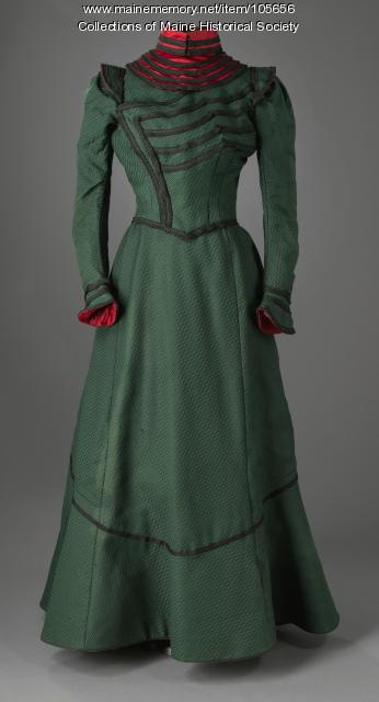 Green wool dress with red satin and black braid details, ca. 1900