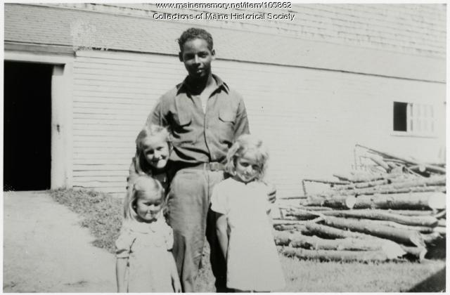 Pvt. Florentino Lopez with Atkins children, North Yarmouth, 1942