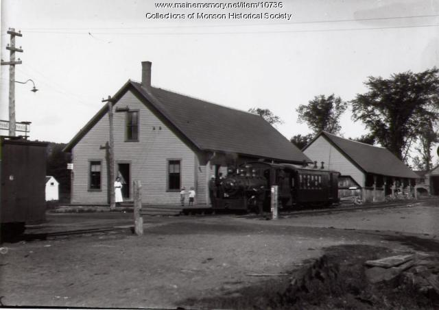 View of Monson Station with engine and passenger car