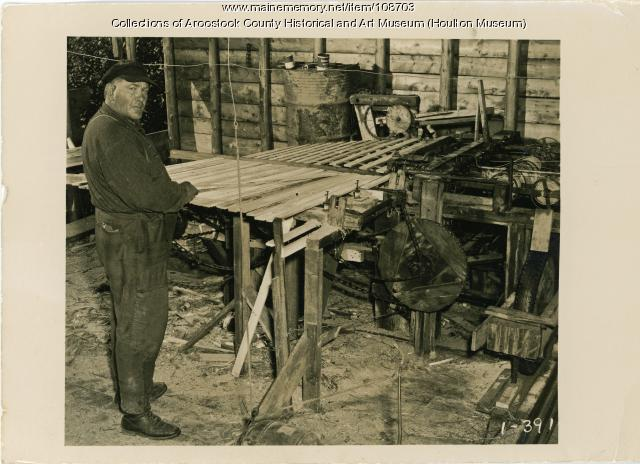 Chester Nickerson making snow fence, Hodgdon, 1950