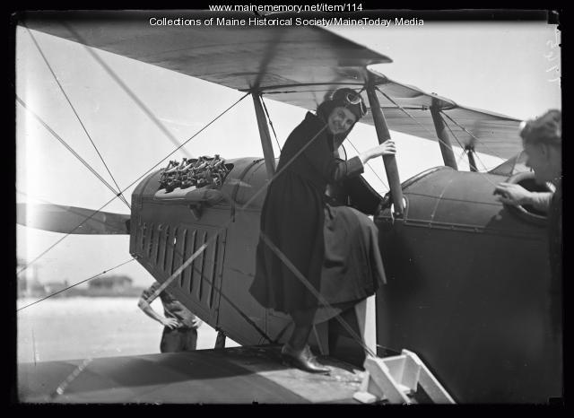 Riding in a biplane, Old Orchard Beach, 1920