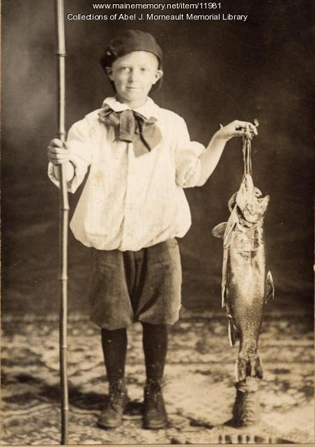 Lawrence Plante with a fish he caught, c. 1920