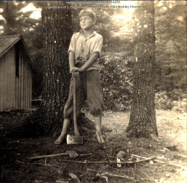 Good Will Orphan Boy in the woods with an ax, ca. 1910
