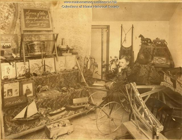 Merle P. Chaplin with toys, South Portland, ca. 1895