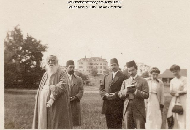 'Abdu'l-Baha, interpreters and women standing near the Inn at Green Acre, Eliot, 1912