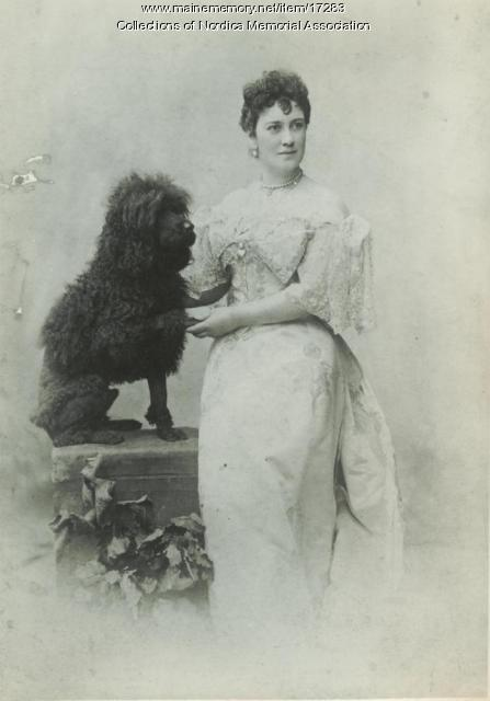 Opera singer Lillian Nordica and her poodle, Turk, 1894