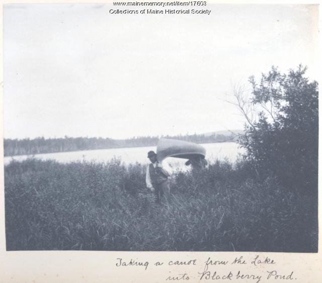 Carrying canoe, Ragged Lake, 1894