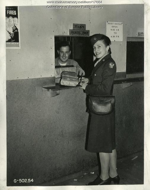 Pvt. Vera Edwards mails a Christmas package, Bangor, 1944