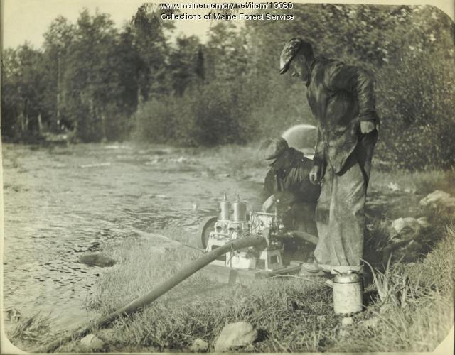 Setting up fire pump, ca. 1930