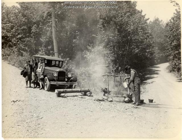 Dousing campfire, ca. 1930