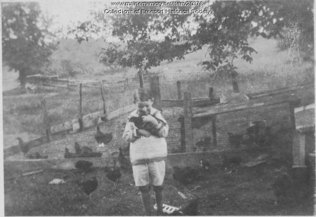 Boy with chicken, Pettengill farm in Freeport, ca. 1920