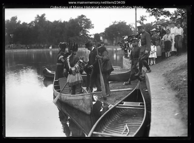 Wabanaki people paddle Gov. Milliken around Deering Park, Portland, 1920