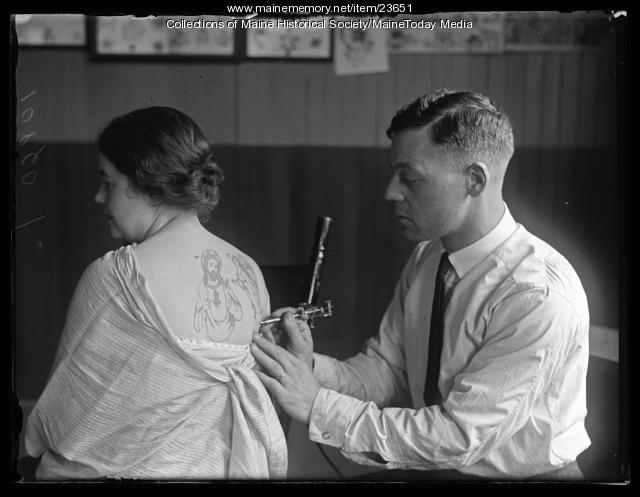 Woman getting a tattoo, Portland, 1925