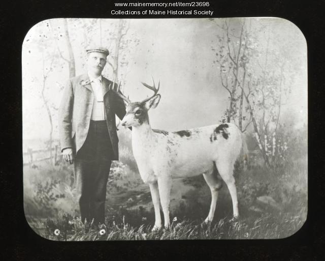 C.H. Randall with white deer, Greenville, ca. 1900