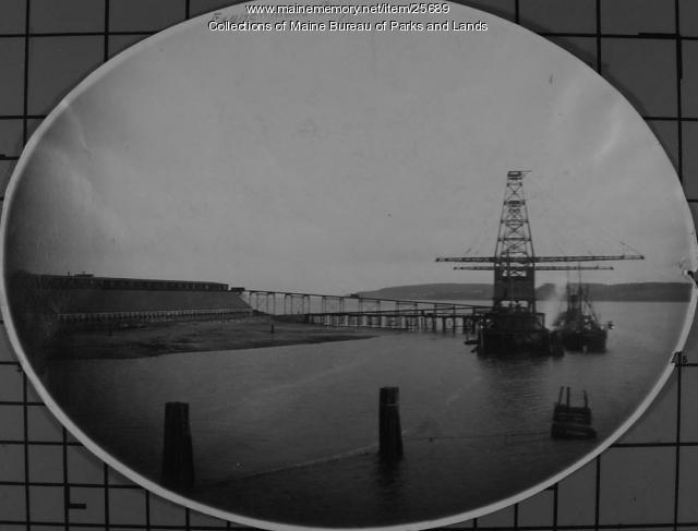 Battleship filling with coal at Lamoine Coaling Station, ca. 1910
