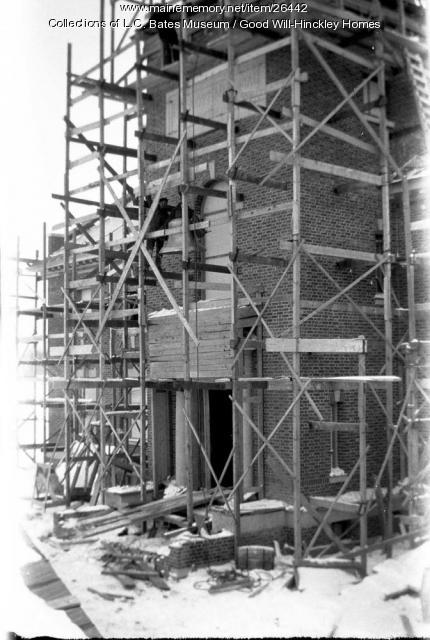 Raising the bell up to the tower in Prescott Building, Fairfield, ca. 1915