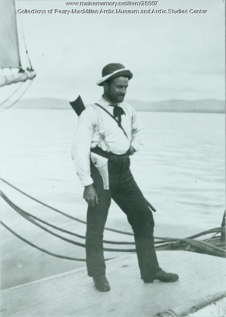 Dennis Cole posing with equipment, Labrador, 1891