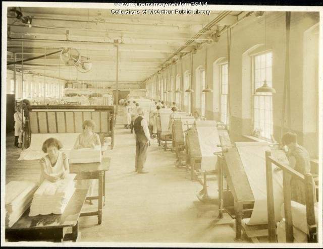 Inspecting and packing cloth at Pepperell Mills, Biddeford, ca. 1925