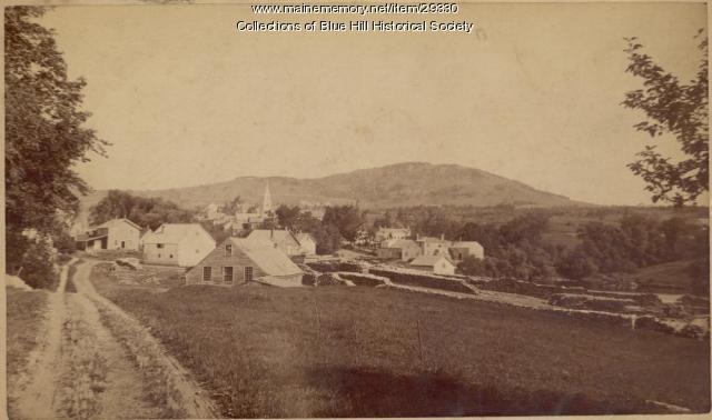 Lumber piled on town wharf, Blue Hill, ca. 1890