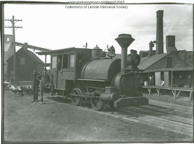 """Dewey"" engine in front of pulp mill, ca. 1910"