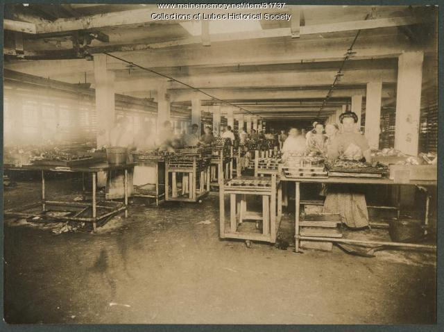 Packing fish in cans, Lubec, ca. 1900