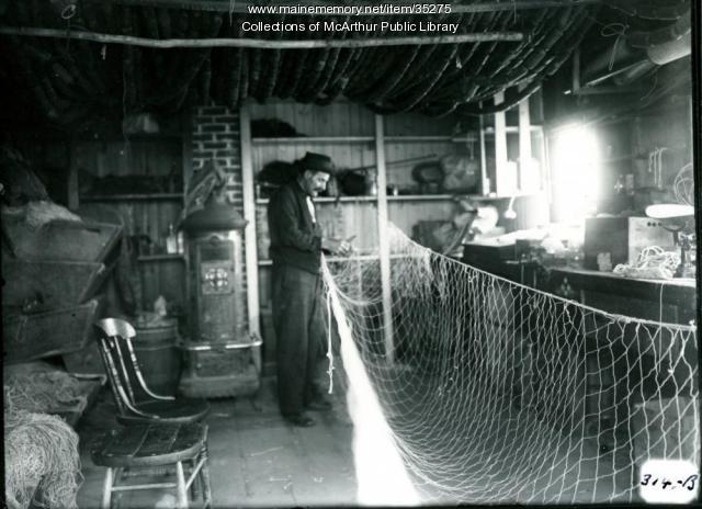 Fisherman repairing nets at Biddeford Pool, 1917