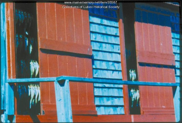 Hanging herring in McCurdy's Smokehouse, Lubec, 1989
