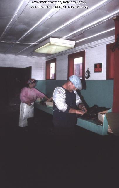 Skinning herring at McCurdy's, Lubec, 1989