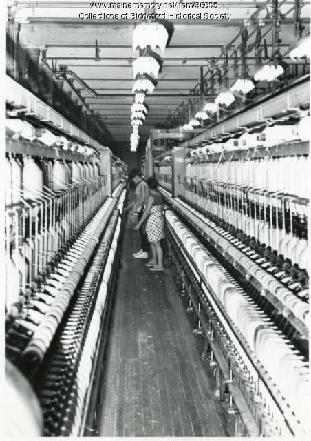 Spinner working at her spinning frame, Biddeford, 1966
