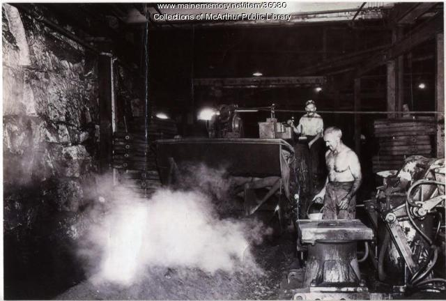 "Workers ""cutting sand"" at the Saco-Lowell Shops, Biddeford, circa 1950"