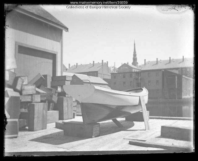 Boat behind store, Bangor, ca. 1895