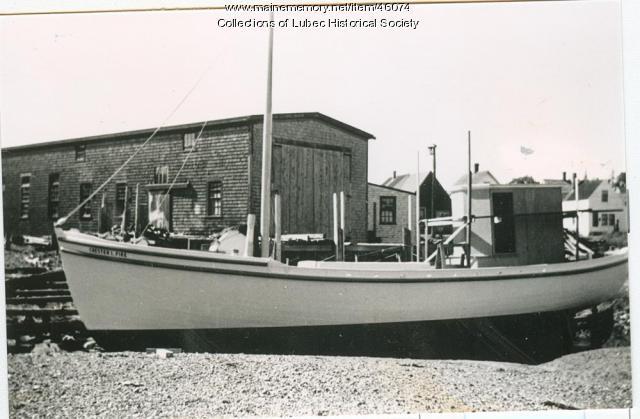 """Chester L. Pike"" outside Colson Boat Shop, Lubec ca. 1950"