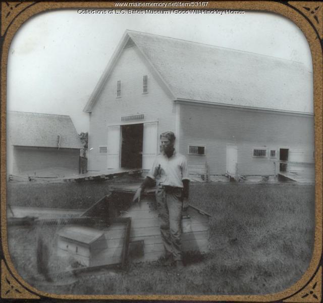Good Will boy feeding chickens, Fairfield, ca. 1925