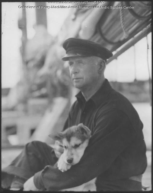 MacMillan with puppy on 'Bowdoin,' 1939