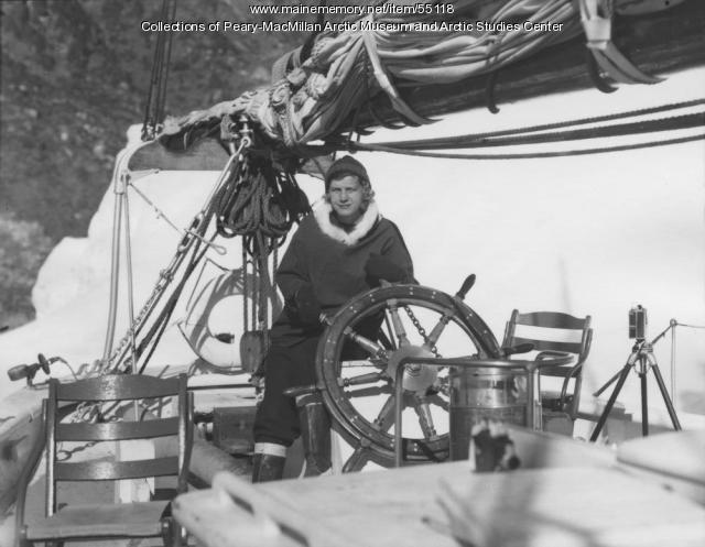 Miriam MacMillan at the wheel, Northwest Greenland, 1948