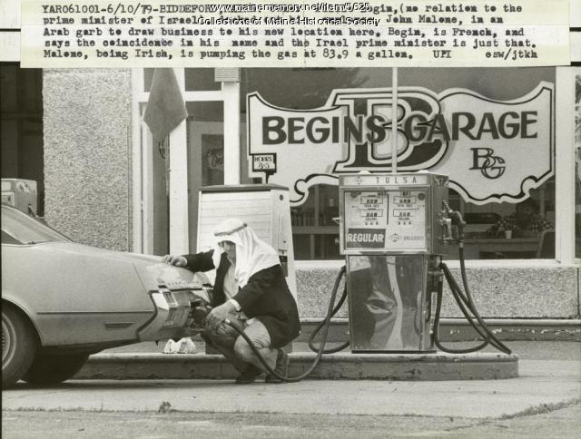John Malone pumping gas in costume, 1979