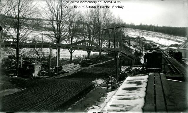 Brackley's conveyor over Depot Street, Strong, ca. 1924