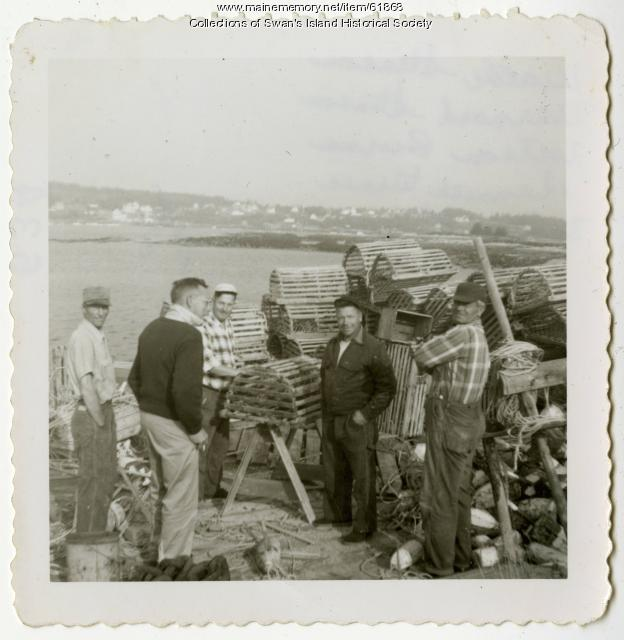 Five men discussing the lobster haul of the day, Swan's Island, 1950