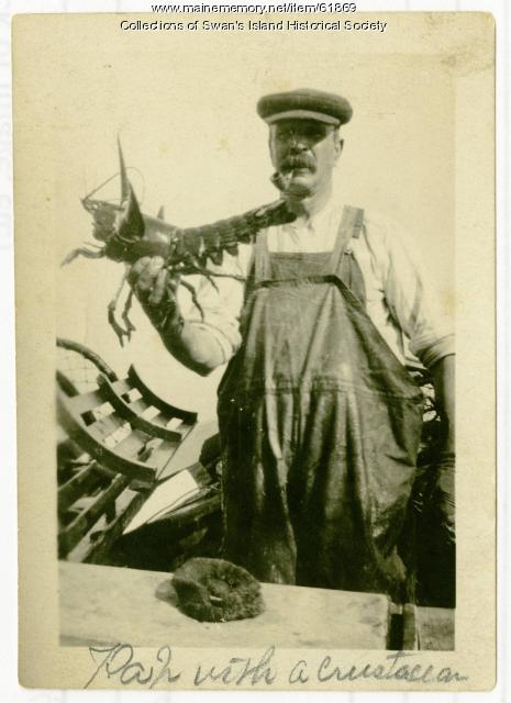 Walter Joyce with lobster, Swan's Island, ca. 1930