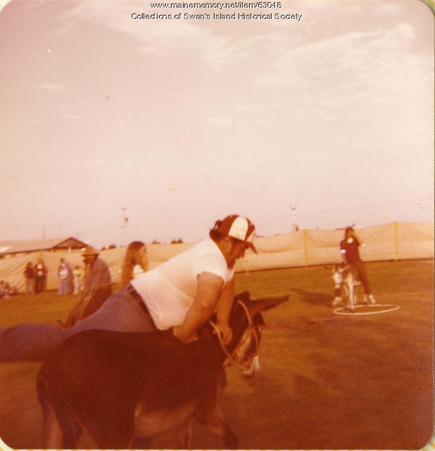 David Carlson getting ready for donkey softball, Swans Island, 1978