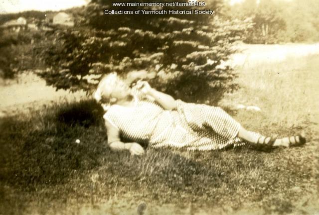 Mrs. Duran lounging, Cousins Island, ca. 1920