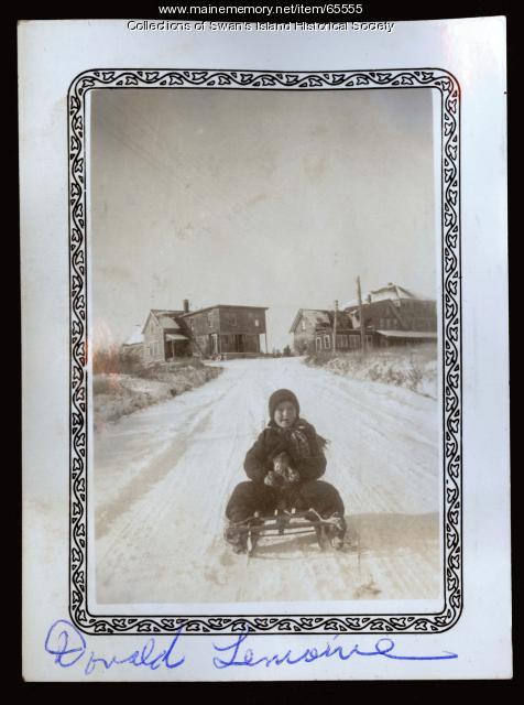 Donald LeMoine sledding, Swan's Island, ca. 1940