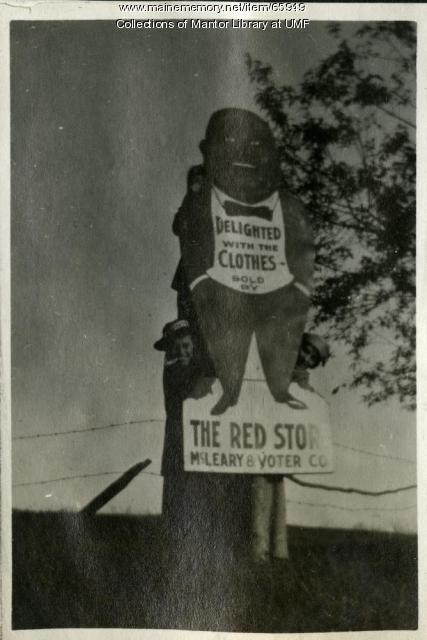 Farmington State Normal School students climbing a billboard, ca. 1917