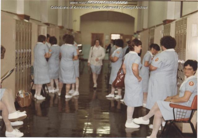 Gilman School LPN students in hallway, Waterville, 1983