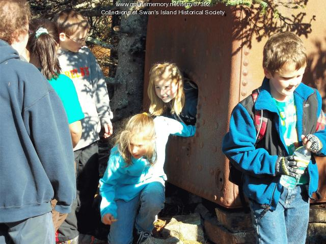 Students around old quarry boiler