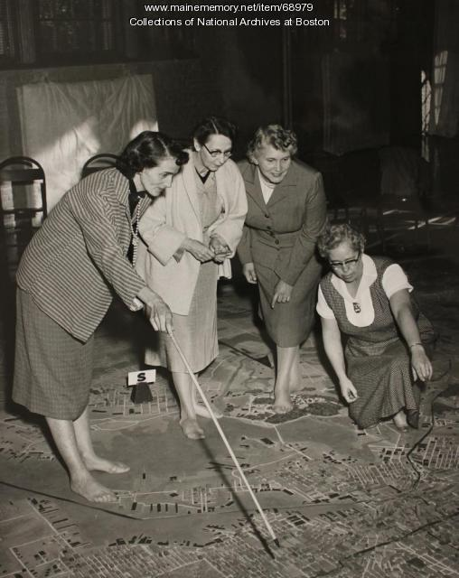 Women staff working with a Civil Defense map of Baltimore, 1954