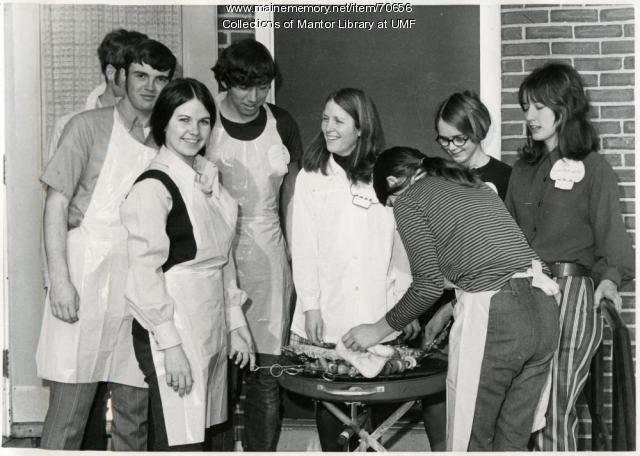 Home Economics students grilling, University of Maine at Farmington, ca. 1971