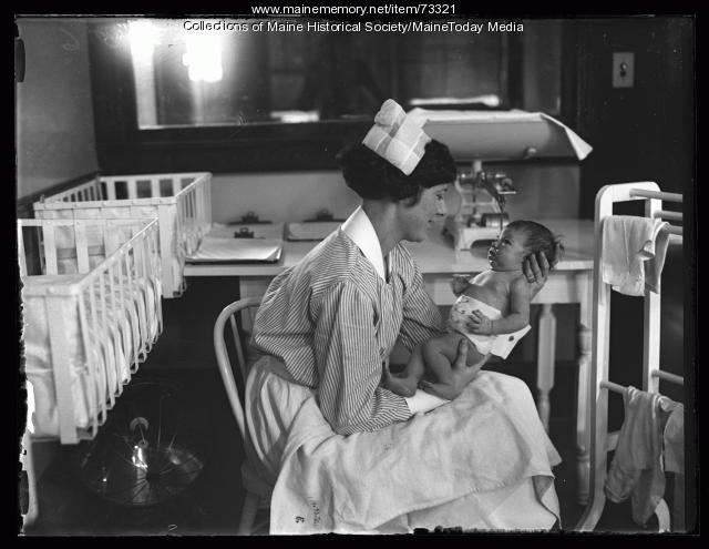 Nurse with baby in Maternity Ward of Maine General Hospital, Portland, 1926