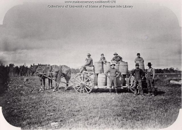 Potato diggers with wagon load of potatoes, Washburn, 1910