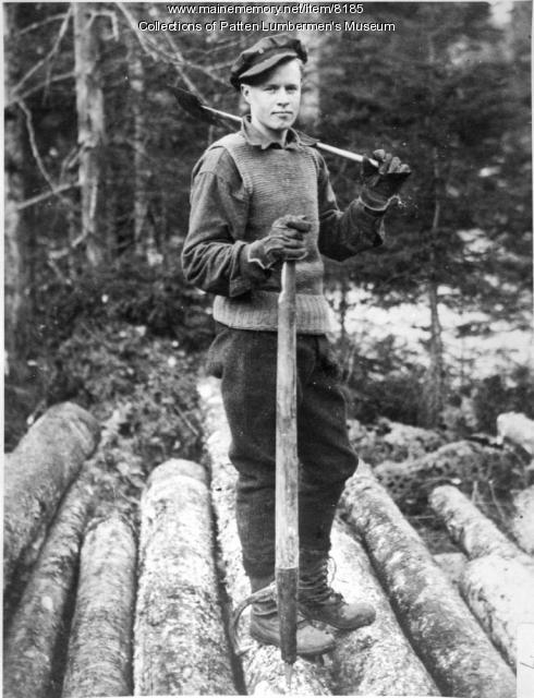 Log Pile and Worker-Fred Howard